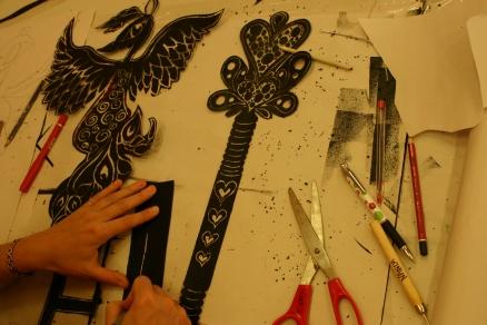 Kate preparing artwork for silk banner, Tom Price