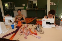 Cass and Danielle sewing the teepees
