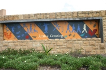 Jubilee Crossing entranceway mural designed by Nancy Brown and Forest Lake SHS students