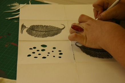 Artist making seaweed book