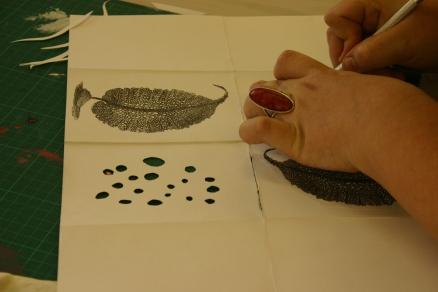 Artist making seaweed book