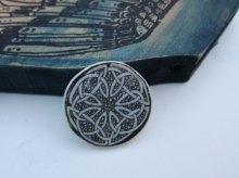 celtic knot brooch black wing