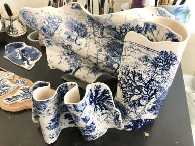 Nancy Brown sculptural porcelain scrolls, mosaic pieces.