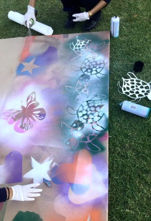 Layering stencils for spray painting